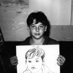 Garçon avec son portrait